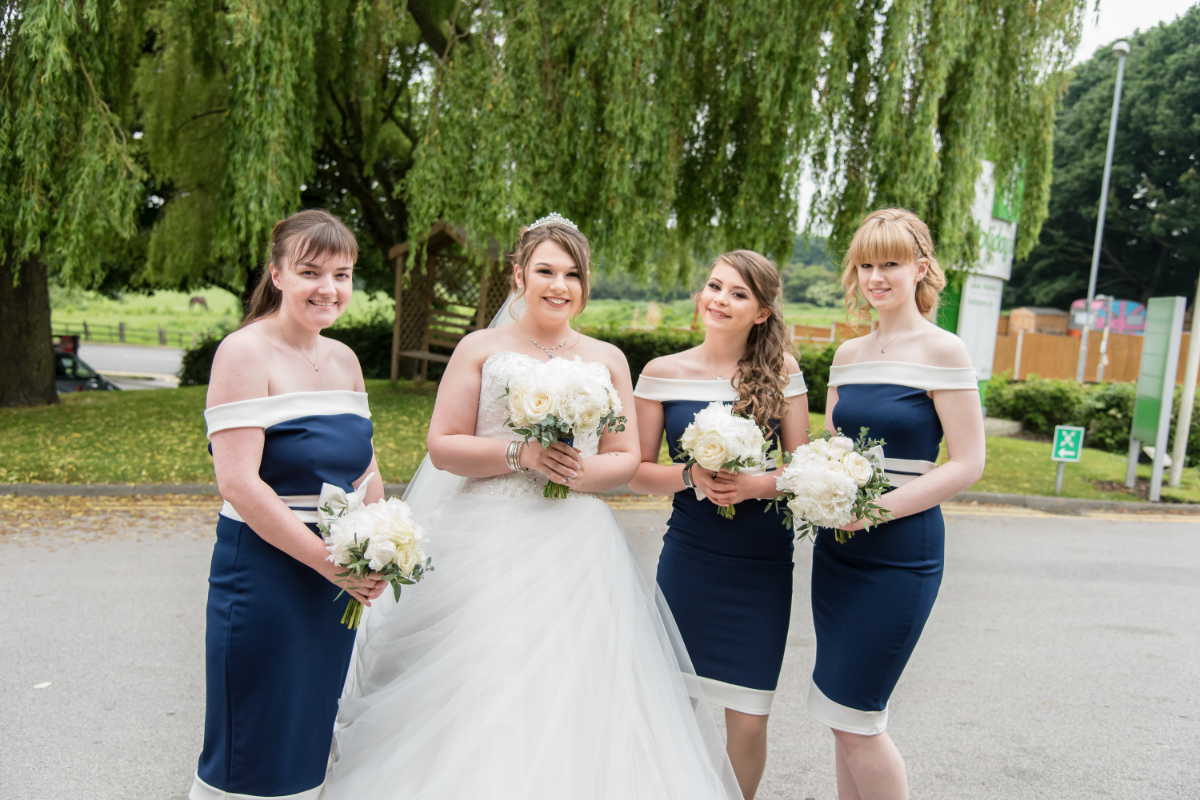 bride with three bridesmaids smiling
